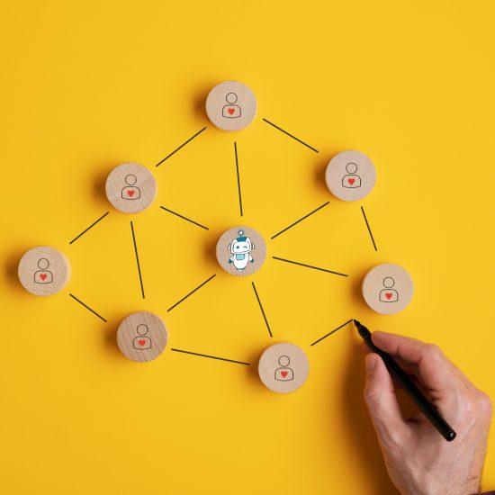 conección entre personas ilustrada en cirulos de madera y creante bot en el centro